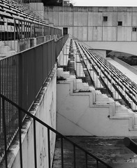 Olympic Swimming Pool (teaselbrush) Tags: barcelona city urban geometric pool car sport stairs swimming spain view geometry decay steps cable games aerial disused 1992 olympic olympics montjuic