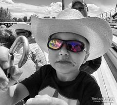 May 22 2016 - Titus at Carmen's graduation. Photo by Cuca (lazy_photog) Tags: school food color hat sunglasses mouth photography high cowboy sister graduation shades grandson lazy elliott selective photog 052216cucagraduation