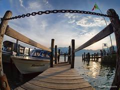 Lago d'Orta (NIKOZAR (Nicola Zaratta)) Tags: sunset boats barche piemonte lagodorta samyang75f35 em10markii