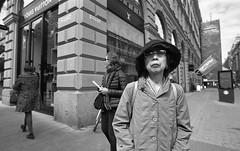 Street portraits (Emptiness of Helsinki) Tags: blackandwhite film lady contrast 35mm finland asian helsinki candid grain streetphotography streetportrait rodinal decisivemoment selfdeveloped filmphotography tonality streetcompo uwaportrait classicdeveloper