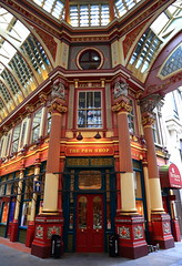 The Pen Shop - Leadenhall Market (Paul Beech) Tags: old blue light red england colour building london history window yellow still flickr mood image market outdoor pov decorative quality awesome dragons wideangle arches structure symmetry best doorway era handheld historical symmetrical column arrow colourful framing vaulted capture pillars impressive embossed compostion leadenhall directional ruleofthirds stgeorgescross leadinglines bygone ef24105mmf4lisusm enblem thepenshop trending canoneos6d paulbeech