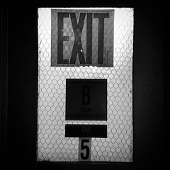 (hawkeye6363) Tags: blackandwhite signs square squareformat exit blackandwhitephotographer uploaded:by=instagram
