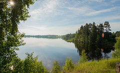 still (lagerberg media) Tags: sun lake nature scenery sweden north northern norrland