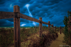 Sauble Beach Lightning (murf50) Tags: sky lake beach nature water night clouds fence dark sand waves greatlakes lightning vegitation lakehuron owensound paulmurphy saublebeach fencepost