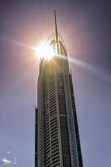 Sun Behind The Q1 Tower (k009034) Tags: australia copyspace goldcoast queensland architecture building clouds landmark nopeople oceania shine sky sun sunshine tall tower travel traveldestinations windows