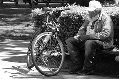 Moment of Quiet Contemplation (lsmadison) Tags: park blackandwhite bw bike dc washington candid sony dcist dupont dupontcircle rx100 dscrx100