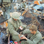 14 Feb 1968, Hue - Packs of cigarettes are distributed to U.S. Marines during pause in fighting on rubble-filled sight. thumbnail