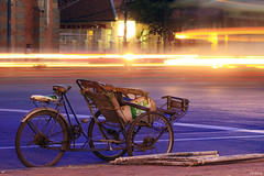Cyclo on the Saigon street (-clicking-) Tags: lighting street city longexposure light lamp night rural exposure alone nightshot atmosphere vietnam lonely saigon cyclo ambiant powerofart bestcapturesaoi elitegalleryaoi inspiringcreativeminds