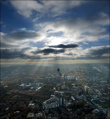 Sun rays over London (Katarina 2353) Tags: uk trip travel november autumn light sunset vacation sky urban london tower architecture clouds buildings europa cityscape shadows view unitedkingdom scene strata 23 rays urbanscene 2013 katarinastefanovic katarina2353