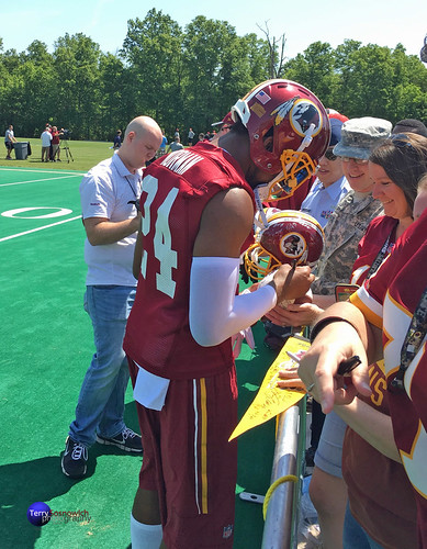 Newly acquired CB Josh Norman signs autographs on opening day of OTAs for the military.