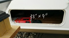 """Curb side rear storage - 33""""W x 9""""H (JD and Beastlet) Tags: travel family camping camp vacation foot slide together vehicle trailer rv 27 camper 2012 recreational rockwood 2701ss"""