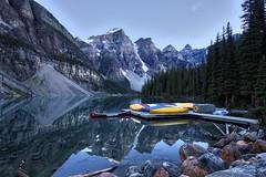 stillness (John Andersen (JPAndersen images)) Tags: park trees canoes banff morainelake borderfx