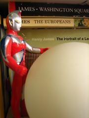 bookshelf creature (Ladybadtiming) Tags: red home silver ball toy globe shine thing books bookshelf creature find henryjames helemt