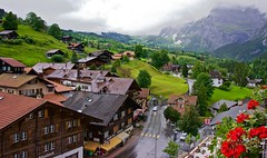 Postcard perfect Switzerland (somabiswas) Tags: grindelwald switzerland landscape hotel flowers chalet alps scenery mountains clouds bernese oberland saariysqualitypictures flickrdiamond diamondclassphotographer