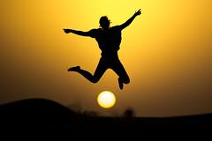 JUMP AROUND (CUMBUGO) Tags: light sunset woman sun sunlight girl yellow backlight ball dessert fun jump sand nikon dubai nikkor f28 d800 70200mm d800e