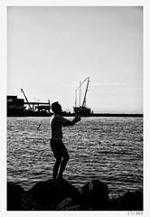 Ervin (Alja Ani Tuna) Tags: sea summer man silhouette seaside fishing fisherman year slovenia 17 nikkor f18 dailyphoto throw d800 izola 85mmf18 project365 17365 nikkor85mm photo365 onephotoaday nikond800