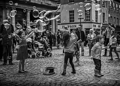 bubble kids (Daz Smith) Tags: city uk girls portrait people urban blackandwhite bw playing streets blancoynegro boys monochrome kids canon children blackwhite bath play candid citylife thecity streetphotography bubbles canon6d dazsmith
