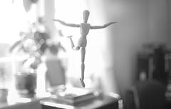 (Attila Pasek) Tags: 55mmf12 bw bokeh fly levitate manikin nikon pose room window wooden