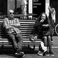 Good to know you... (Akbar Simonse) Tags: street people urban bw woman man holland blancoynegro netherlands monochrome sunglasses bench square zwartwit eating candid nederland streetphotography bank denhaag shades bn hungry bouquet haag thehague eten streetshot straat zonnebril honger vierkant lahaye sgravenhage agga straatfotografie straatfoto img4187 bosjebloemen akbarsimonse goodtoknowyou