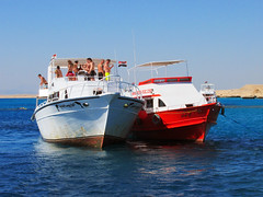 Boats on the Red Sea (shaire productions) Tags: egypt egyptian travel world image picture photo photograph sea ocean marine coast coastal shore beach photography travelphotography redsea resort cruise boat ship sailing water bay blue waters nature outdoors hurghada tour tourism floating beauty scenery
