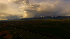 Lemhi Valley Stormscape 21 (Dan Beland) Tags: sky usa cloud art nature water field grass clouds fence landscape unitedstates artistic outdoor hill idaho pasture valley vista northamerica rockymountains verdant serene lush cloudscape barbedwirefence mountainscape drone cloudreflections dji beaverheadmountains salmonidaho quadcopter lemhicounty phantom3professional lemhirivervalley