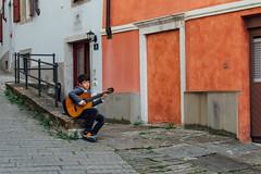 Trieste, 2016 (Antonio_Trogu) Tags: italia italy friuli trieste streetphotography boy young guitar chitarra ragazzo playing player antoniotrogu nikond3100 sitting 2016 street urban candid