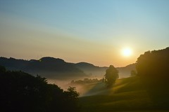 Lit Fog (imkaifilbey) Tags: blue sun sunlight mist mountains green grass yellow fog sunrise landscape foggy hills land fields rays