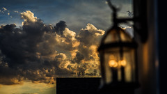 The Lantern is Lit (Gold Element Photography) Tags: light sunset house lamp night clouds evening focus depthoffield
