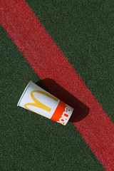 Untitled (KristineMarieVann) Tags: mcdonalds fastfood consumer field sportsfield shadow cup green red yellow abstract photography fineart fineartphotography simple