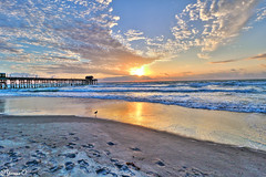 Beautiful Morning (Yvonne Oelsner) Tags: blue sky orange seascape color colour reflection beach nature water clouds strand contrast sunrise landscape coast pier meer florida dramatic himmel wolken landschaft kontrast sonnenaufgang hdr cocoabeach