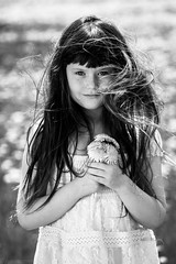 Dandy Bouquet (Kilkennycat) Tags: flowers portrait blackandwhite bw girl monochrome canon hair children happy spring child windy dandy dandelions 500d kilkennycat t1i ryanconners 100mm28l