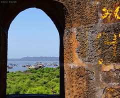 View of Vasai port from a window of Vasai Fort (shridevparikh) Tags: seascape port fort vasaifort vasaiport