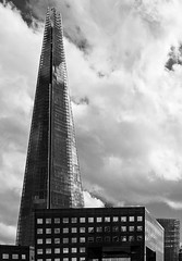 The London Shard (BW-IR) (EM5 & Panasonic 25mm F1.4) (markdbaynham) Tags: street city sky urban bw cloud white black building london monochrome architecture modern digital skyscraper lens ir four prime f14 capital olympus retro panasonic micro infrared third metropolis tall shard 43rd omd ccs 25mm em5