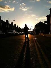 Sun beat street (Gareth83cdf) Tags: street city uk sunset portrait urban inspiration man art me beer silhouette wales pose landscape town experimental creative cardiff figure mobilephone director cathays