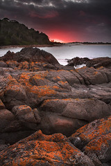 Orange Rocks || Hawks Nest (edwinemmerick) Tags: ocean longexposure sunset sea seascape nature water canon eos coast rocks sundown nest shoreline australia le shore nsw 7d slowshutter coastline edwin beack hawks emmerick edwinemmerick