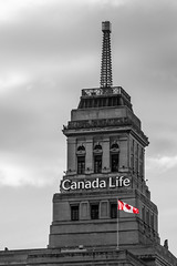 Canada Life (Matt M S) Tags: life street city red urban white toronto ontario canada black streets color colour building weather architecture 1931 university metro flag arts landmark icon architectural queen spire iconic beacon selective beaux blogto torontoist