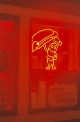 Glowing Frankfurter of Doom (Anne Abscission) Tags: seattle 35mm washington lomo downtown neon glow waterfront 200asa expired smenasymbol agfavista crossscreen lomowalk thefrankfurter