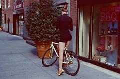 Woman on Bike (slightheadache) Tags: nyc newyork film slidefilm pentaxk1000 expired slides lightroom 2013 kodakslidefilm