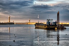 Summers Eve - Whitby, North Yorkshire, England. (Darren Flinders) Tags: sea summer cloud lighthouse clouds reflections boats coast harbor boat seaside harbour whitby whitbypier
