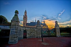 Day 279 - Peace Palace Gates (William Adam) Tags: sunset tower clock sandstone gate day thenetherlands bluesky denhaag lampost thehague peacepalace redbrick whispyclouds pwpartlycloudy