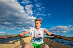 Rowing along (e_impact) Tags: blue trees summer cloud sun lake green sunshine clouds canon finland boat concentration cool young bluesky christian teenager rowing oars practise hopeful grp portraitofboy