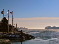 Erie's Mouth (Patrick (Essex Masque)) Tags: ice river flags greatlakes erie boblo amherstburg
