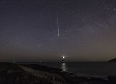 'To Catch A Falling Star...' - Penmon, Anglesey (Kristofer Williams) Tags: sea sky lighthouse seascape beach wales night stars landscape coast nightscape north meteor darksky milkyway ynysmon anglesey penmon meteorshower lyrid