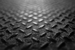 Faster Than Bad News (belleshaw) Tags: blackandwhite detail metal rust bokeh decay wear step age diamondplate orangeempirerailwaymuseum