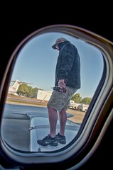 "mechanic is ""winging it"" (Pejasar) Tags: oklahoma window framed tulsa mechanic repairs powertool windowshot flightdelay wingingit learjet35 airplanemechanic"