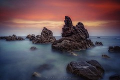 Vespers - Vsperas (Blai Figueras) Tags: longexposure sunset sea sky costa sun seascape beach water clouds reflections landscape atardecer coast mar seaside agua rocks flickr stones horizon atmosphere playa paisaje girona le cielo paraiso costabrava rocas lloretdemar silkeffect