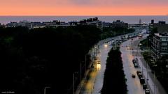 Rain at sunset... (jaap spiering   photographer) Tags: sunset sea color colour beach rain strand coast streetphotography beachlife zee denhaag thehague regen kust kleur 070 gx8 strandleven jaapspiering jaapspieringphotographer jaapspieringfotografie