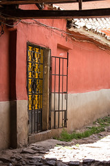 IMG_4408 (monique.timlick) Tags: bright colourful red sunshine sunny cusco peru mossy stonework alleyway buildings city urban historical southamerica canon orange doorway door