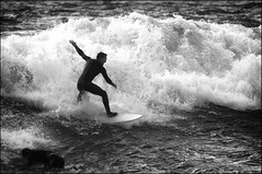 Fun in the Waves II (eekaphot) Tags: sea newzealand people blackandwhite bw beach water person mono surf waves pentax outdoor gray sigma surfing titahibay justpentax sigma400mmf56apotelemacro k5ii