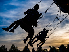 The thrill ... (martina.stang) Tags: sunset people silhouette freedom flying streetphotography carousel thrill